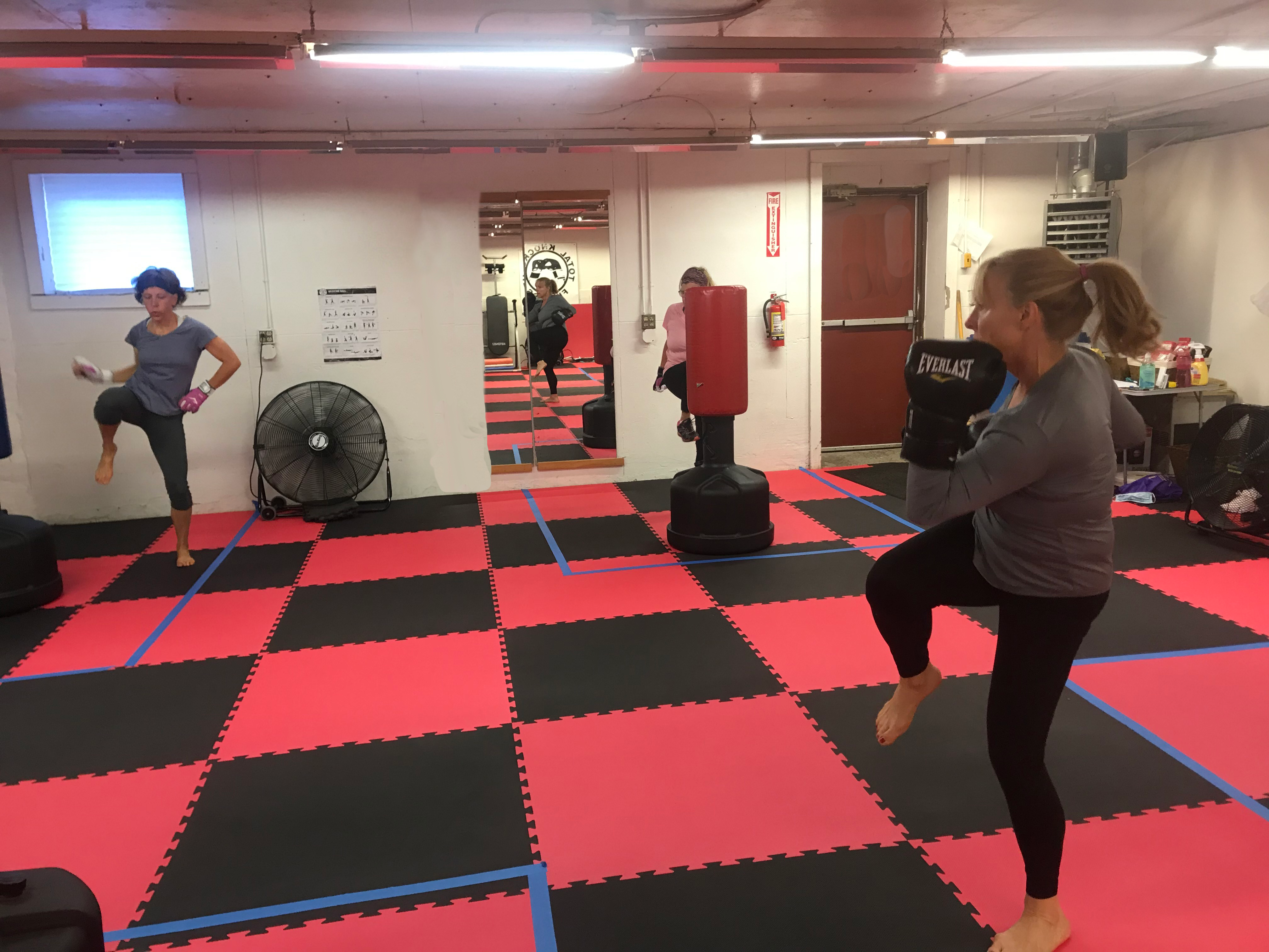 two women exercising with gloves on as part of kickboxing